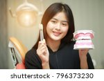 asian girl holding tooth and... | Shutterstock . vector #796373230