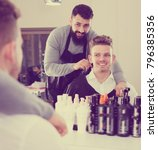 cheerful hairdresser making... | Shutterstock . vector #796385356