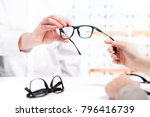 optician giving new glasses to... | Shutterstock . vector #796416739
