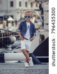 a small boy in a marine style... | Shutterstock . vector #796435300