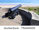 Small photo of Bamburgh, Northumberland / UK - 05/31/17: Late 18th century 32-pounder naval cannon at Bamburgh Castle.
