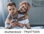smiling tattooed girl hugging... | Shutterstock . vector #796477654