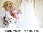 bride playing with two dogs in... | Shutterstock . vector #796480546