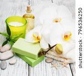spa products and white orchids... | Shutterstock . vector #796536250