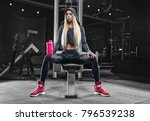 in the gym after a heavy... | Shutterstock . vector #796539238