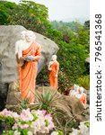 statues of monks on a rock with ... | Shutterstock . vector #796541368