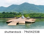 small jetty for ferry on green... | Shutterstock . vector #796542538