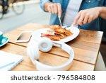 man cutting sandwiches at... | Shutterstock . vector #796584808