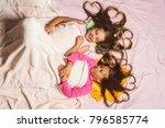 kids in pink pajamas under... | Shutterstock . vector #796585774