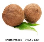 Two Whole Coconuts With Green...