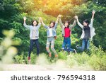 young people jumping together... | Shutterstock . vector #796594318