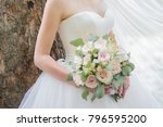 bride with a bouquet near the... | Shutterstock . vector #796595200