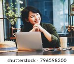 happy young asian woman working ... | Shutterstock . vector #796598200