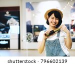 happy young asian woman holding ... | Shutterstock . vector #796602139