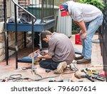 repairman leveling step | Shutterstock . vector #796607614