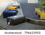 suit case on luggage conveyor... | Shutterstock . vector #796615903