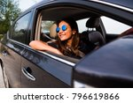 asian woman driving on the car... | Shutterstock . vector #796619866