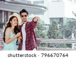 tourists happy couple asian... | Shutterstock . vector #796670764