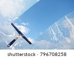rubber squeegee cleans a soaped ... | Shutterstock . vector #796708258