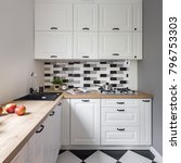Stock photo small kitchen with classic white furniture and modern tiles 796753303