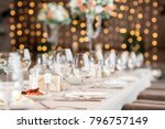 focus on glasses. Banquet table in the restaurant, the preparation before the banquet. the work of professional florists.