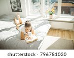 beautiful smiling woman reading ... | Shutterstock . vector #796781020