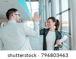 two business people high five. ... | Shutterstock . vector #796803463