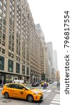 Small photo of NEW YORK, USA - Sep 17, 2017: Taxi on the streets of Manhattan. Manhattan is the most densely populated of the five boroughs of New York City.