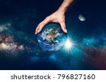 hand holding the world  symbol...   Shutterstock . vector #796827160