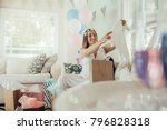 pregnant woman opening a new... | Shutterstock . vector #796828318