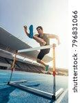 runner jumping over an hurdle...   Shutterstock . vector #796831066