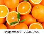 fresh orange fruits with green... | Shutterstock . vector #796838923