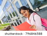 student with notebook next to... | Shutterstock . vector #796846588