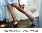 beautiful legs of the bride | Shutterstock . vector #796879663