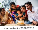 Indian Family Celebrating A...