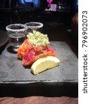 salmon and tuna sashimi  vodka  ...   Shutterstock . vector #796902073