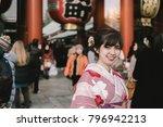 attractive asian woman wearing... | Shutterstock . vector #796942213
