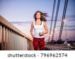 young caucasian woman running... | Shutterstock . vector #796962574