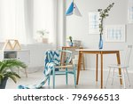 patterned blanket on blue chair ... | Shutterstock . vector #796966513