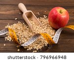 wooden spoon with rolled oats... | Shutterstock . vector #796966948