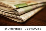 newspapers. pile of folded and... | Shutterstock . vector #796969258