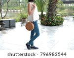 woman with fashionable rattan... | Shutterstock . vector #796983544