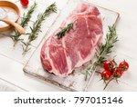 raw pork meat on white wooden... | Shutterstock . vector #797015146