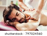young man is having massage on... | Shutterstock . vector #797024560