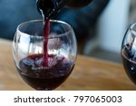Small photo of Red wine is poured into a glass - the concept of drunkenness and alcoholism