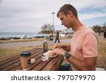 young man eating breakfast... | Shutterstock . vector #797079970