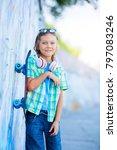 cute boy with skateboard...   Shutterstock . vector #797083246