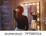 woman in a beauty salon looks... | Shutterstock . vector #797085316