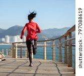 sporty fitness female runner... | Shutterstock . vector #797088619