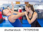 young woman and her trainer are ... | Shutterstock . vector #797090548